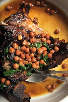 This lamb shoulder—slow-braised with pomegranate molasses and chickpeas—is the best of all possible worlds: smoky and crispy, soft and tender, sweet and savory. Philly Restaurants, Lamb Dinner, Lamb Shoulder, Eastern Cuisine, Food Challenge, Yummy Smoothies, Food Network Recipes, Food Inspiration, Love Food