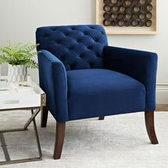 The right tuft. A masterful mix of comfort and style, the Elton Chair has arms the perfect height for reading. This library chair's padded seat, angled wood legs and classically tufted back give it a touch of casual, low-key sophistication.