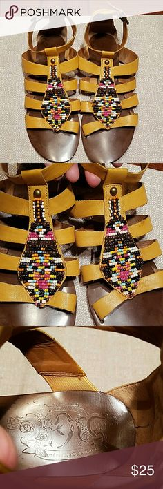 Nine West Rustic mustard colored leather strappy flat sandals from Nine West Vintage America collection. Embellished with intricate beading in Native American style. In good condition, a few slight marks on back of heel and L strap (pic 7 and 2) Nine West Shoes Sandals