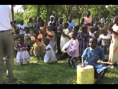 Drum & Dance: Kenyan Children Singing and Dancing Wonderful to watch >>>  Young and old.   A+ for participation.
