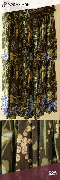 Ann Taylor Loft skirt Floral with blue,green, beige, black floral.  Invisible zipper up one side. 1 pocket each side (can't see them). Band around waist with a tie belt you can choose whether to wear or not.  Very cute. Ann Taylor Skirts Midi