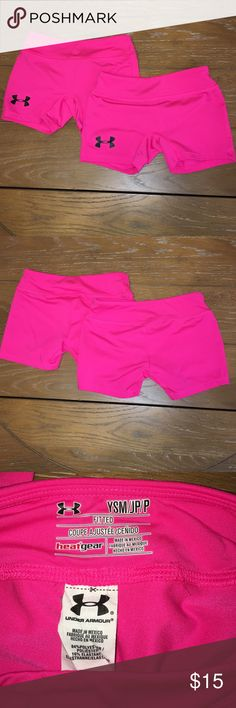 Girls under armour fitted heat gear shorts YSM Girls under armour fitted heat gear shorts size YSM. Hot pink with black decal logo on right leg. Both are in excellent used condition. 84% polyester, 16% elastane Under Armour Bottoms Shorts