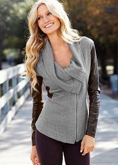 Sweater coat with leather sleeves.
