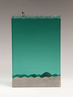 Laminated clear float glass with cast concrete & white bronze. W 230mm x H 340mm x D 120mm.
