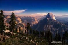 Yosemite Haze - As the stars began to appear the moon rose in the sky.   At this altitude you can see the stars so well they don't have to compete with the bright moon to be seen.   I was pleasantly surprised to spot the Andromeda Galaxy rising just above and to the left of Half Dome.   Haze from a nearby wildfire filled the night time sky and concentrated in the valley below adding an orange hue to the normally white granite of Yosemite Valley casting an eerie light on the valley.    The…