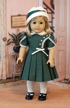 Kit is wearing dark green cotton print dress from the Keepers Dolly Duds pattern Bodice Details. The dress features an overlay on the bodice that is