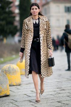 A leopard coat paired with a black dress.