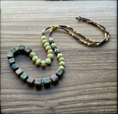 Long, asymmetrical gemstone necklace, made with unakite, jadeite, brass spacers, milefiori glass beads and glass seed beads. By Artigiana Designs - my original design. #necklace #jewelry #handmade #boho #unakite #artigianadesigns