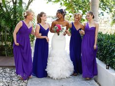 Mismatched blue bridesmaid dresses, the different shades adds vibrancy to the whole look.
