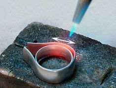 Making a ring: This article covers methods and techniques for hand fabrication, soldering and assembly for a custom designed 950 palladium and cultured pearl ring. #metaljewelry