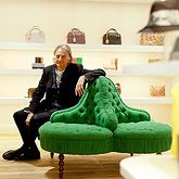 Paul Smith Shop, Shibuya Hikarie ShinQs, Japan.  Paul Smith sitting on the George Smith Conversation Piece.
