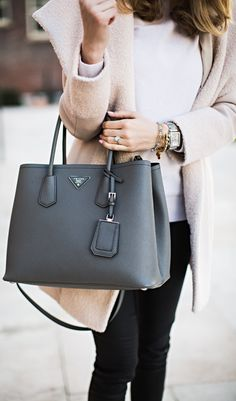 Emily Jackson is wearing a grey suede double bag from Prada