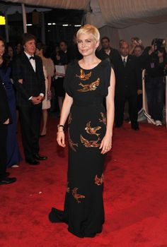 Michelle Williams in swallow dress by MiuMiu | 2011 Met Gala