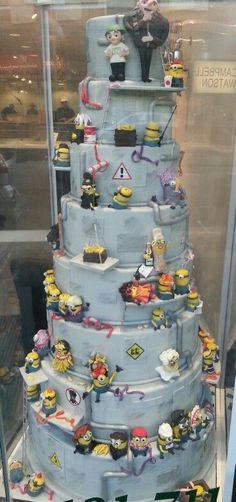 Epic despicable me tiered cake featuring every minion possible from the cake gallery in solihull. Minion madness Uploaded by user