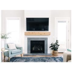 Love this fireplace! The combination of natural wood, shiplap and concrete surround make for the perfect modern farm house feel. See the full modern farmhouse tour on DesignLovesDetail. Fireplace Remodel, Modern Farmhouse Living Room, Home Fireplace, Living Room With Fireplace, Modern House, Decor Interior Design, Farmhouse Fireplace, Fireplace, Modern Farmhouse Decor