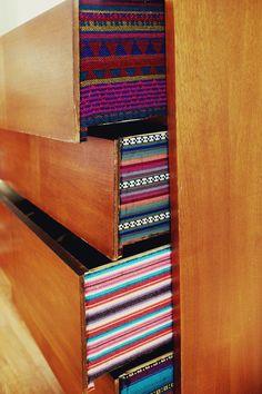 fabric lined dresser drawers via A Beautiful Mess.  Love this idea. #diy #decor