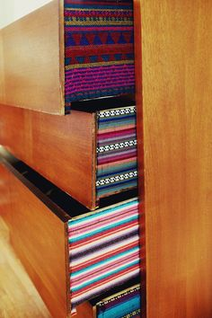 fabric lined dresser drawers via A Beautiful Mess.  Love this idea. #diy #decor