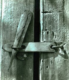 """""""Pinned,"""" by Mike Jahn, via Flickr; The heavy iron lock long lost, a wooden pen secures the sliding door to the Carriage House, Meadow Croft, the former John E. Roosevelt summer estate in Sayville, N.Y. Photo taken in the early 1980s."""