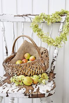 Fall design vignette + apples + burlap + pale green leaf heart wreath + chippy white vintage country chair + wood basket + country + Fall + autumn design