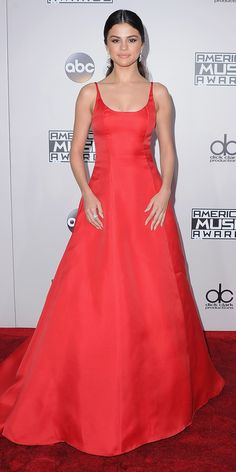 Look of the Day - As minimal as Selena Gomez's elegant red Prada ballgown was at the 2016 American Music Awards, it still made a major impact on the red carpet. She completed her look with Cartier diamonds, Giuseppe Zanotti sandals, and a fuss-free ponytail.