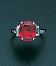 An art deco red spinel and diamond ring, circa 1930 The rectangular step-cut red spinel within a four-claw mount, between shoulders set with baguette and single-cut diamonds, spinel approximately 6.70 carats