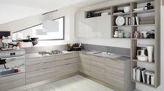 Veneta Cucine: START-TIME Collection. Start off on the right foot by giving your kitchen the youthful feel of a design with pure lines dressed in cool colors and wood finishes that are in step today's trendy natural look.