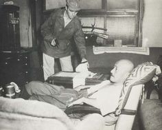 An army intelligence officer attends to Hideki Tojo, the prime minister of Japan during WWII. Tojo attempted to shoot himself in the heart as U.S. troops approached his residence to arrest him. The bullet missed his heart and instead went through his stomach. Tojo made a full recovery before being tried, found guilty of war crimes, and executed.