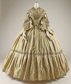 1858-62 Tea Gown, Champagne Gold silk with double point bodice front, gorgeous trimming & deep skirt flounce.