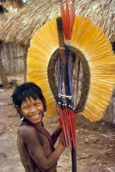 Brazil | Kaiapo Amazonian Indian holding a ceremonial headdress. Amazon rainforest, Galera Caves area. | © Jesco von Puttkamer/Hard Rain Picture Library