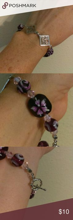 """Handmade Beaded Bracelet Purple, Pink & Silver Handmade beaded bracelet made with decorated purple glass beads, pink bicone crystals and silver accents. This bracelet measures 7.5"""", which is the average bracelet size. An extender can be added if necessary at no charge. Jewelry Bracelets"""