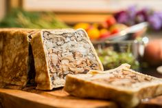 "In this Mushroom Terrine the artfully layered mushrooms like Golden Chanterelles, Trumpet Royals and other varieties, are molded into terrine which when sliced reveals the exciting eye-catching ""interior design""."