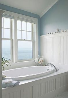 Just A Touch Of Blue Can Draw The Sky And Seascape Into A Well Lit Bathroom (by Connor Homes)