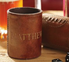 Football Bottle Koozie, leather insulated from Pottery Barn. Perfect for tailgating & a great Father's Day gift idea!
