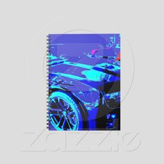 Spiral Notebooks: Chevy Camaro ZL1 in showroom with a 1970 Corvette from Zazzle.com...100% money back guarantee....available nowhere else
