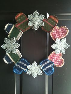Upcycled Felted Wool Snowflake and Mitten Wreath - FREE SHIPPING. $39.00, via Etsy.