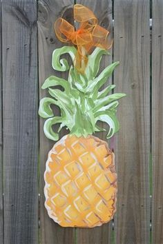 "Pineapple. Personalize with any name or saying. Measures approx. 12""w x 28""h."