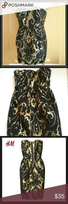 SALE***H&M gold & black strapless dress **Host Pick X2** H&M beautiful Black and Gold metallic Floral Print Dress. Strapless sweetheart neckline. H&M US size 6 EUR size 36. Full back zipper, full lining. Plastic boning in the bodice. gel padding along inside to keep dress from falling. Front pockets. Never worn, tag still attached.   Measurements (flat): center of neckline to hem: 26.75 in; armpit to hem: 26 in. Machine wash cold/dry clean. 48% poly, 33% acry, 15% wool, 4% fib Dresses…