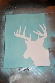 Reindeer Printable, Spray adhesive, Spray Paint, & Canvas. Remove the printable after spray painting, and you are left with this gorgeous piece of art!