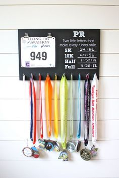 Painted with black chalkboard paint. There are places to record your PRs in the 5K, 10K, half marathon, and full marathon. Chalk included (because