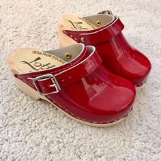 Little Lotta's patent red clogs