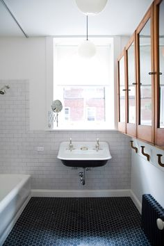 design by Ensemble Architecture double sink with black belly to match black belly of claw and ball foot tub