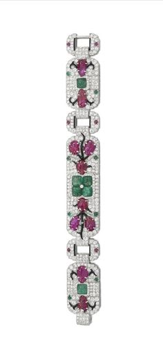 An exceptional Art Deco enamel, gem-set and diamond 'Tutti Frutti' bracelet, by Cartier, New York, 1929 The highly articulated geometric strap, with carved emerald and ruby and black enamel vine motifs, against an old brilliant and single-cut diamond ground, mounted in platinum, diamonds approximately 10.00 carats total, signed Cartier