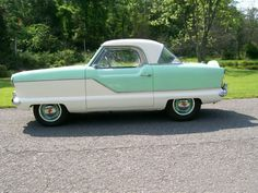 1958 Nash Metropolitan 2 Door Coupe. My uncle had one. Front seat: aunt & uncle. Back: me and the boxer.