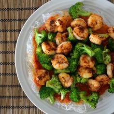 Roasted broccoli and sautéed shrimp top a low-carb Shiritaki noodle cake for a filling and healthy lunch or dinner.