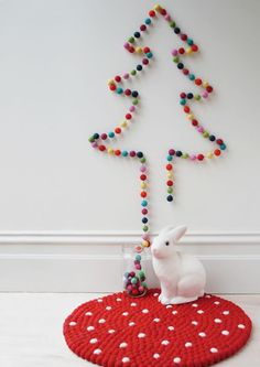 love this idea of shaping a garland into a wall tree found on Down to the Woods ~ how sweet would this be for making a playroom or child's room festive?