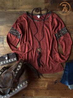 The Butte - Rust top with knitted accents. Tri-blend rust with unfinished seams. Super soft earth tone knitted sleeve and neckline detail. Split slight hi-lo hem. Slight dolman sleeve. Extra long sleeves that can be rolled once. Lightweight and comfy.