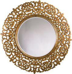 Round Mirror  Drawing on the arabesque motifs of ancient Byzantium, this beveled Round Mirror in a Ginger finish speaks to a love of art and the classics. A true statement piece, the commanding dimensions are balanced by the intricacy of the design—making it the perfect finishing touch for any space.