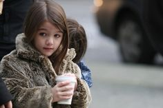 suri cruise...my sister and i totally wore faux fur when we were little too...but it was from the gap.