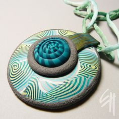 pendant by E.H.design, via Flickr   put the spiral inside of hollow bead.