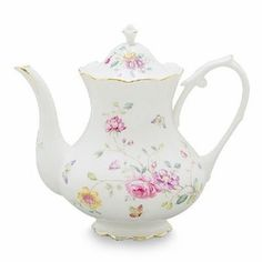 Butterflies and wispy bouquets of multi-color flowers are portrayed in an enchanting garden scene for a stylish look. This porcelain teapot coordinates beautifully with white accessories. Made of high quality porcelain, it has a 4 cup capacity with gracefully accented gold edges. Mix and match this pattern with other floral patterns for your next English Tea Party.